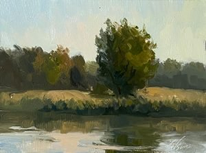 An oil painting of a tree on the bank of a lake